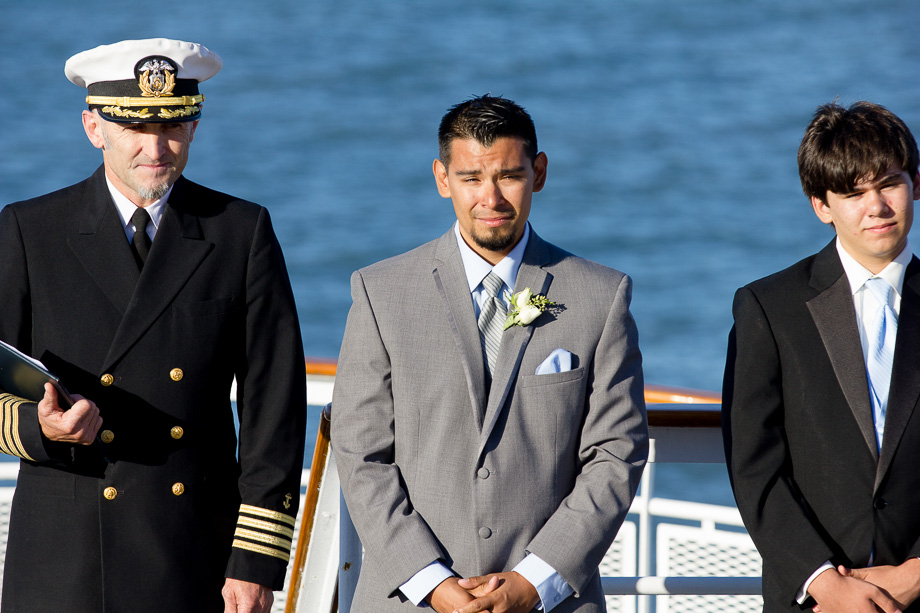 Groom and captain of the cruise ship at the altar
