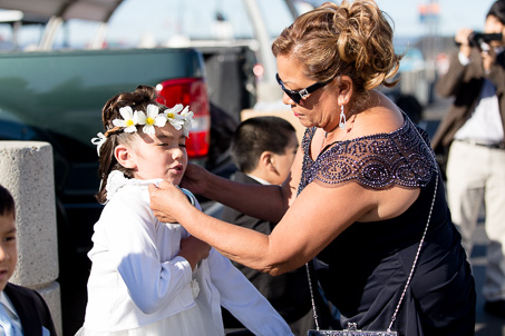 Mom dressing up the flower girl