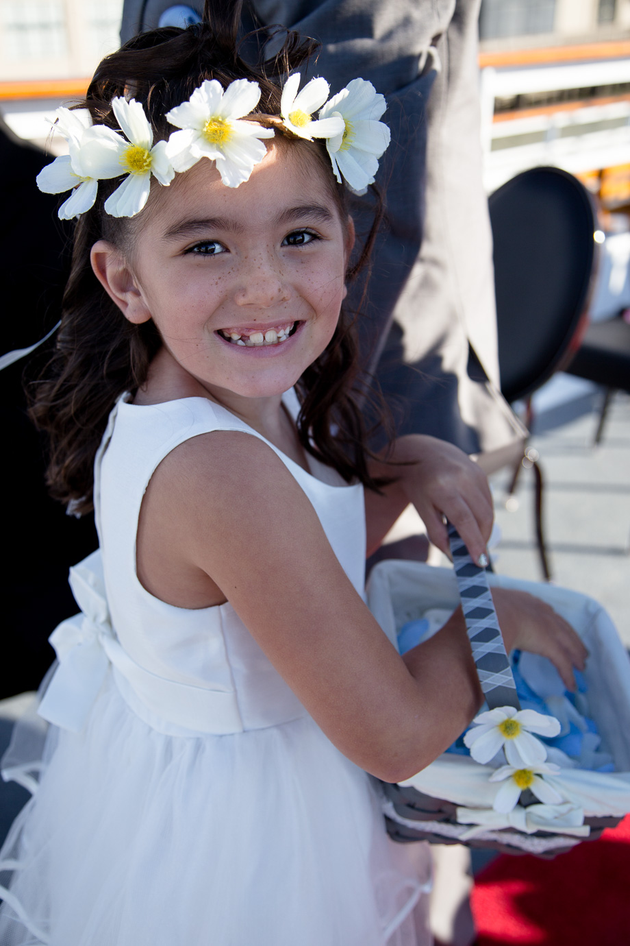 Pretty flower girl smiling with cute flower headband
