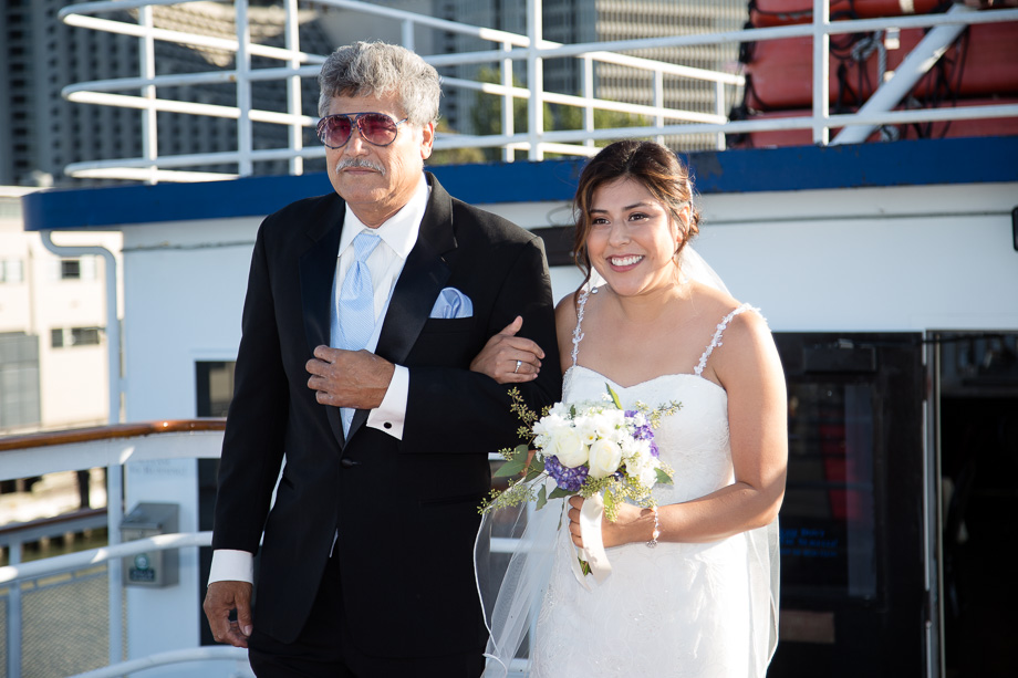 Father and bride walking down the aisle during wedding ceremony