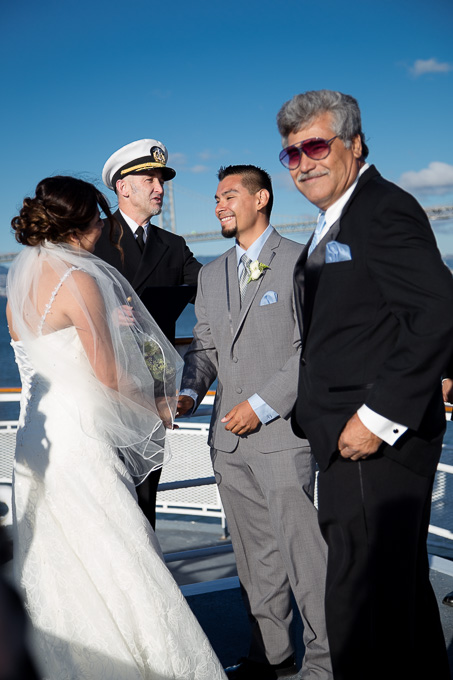 Bride, groom, and captain getting in position for the ceremony