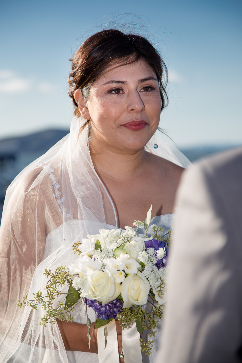 Teary-eyed bride looking at groom