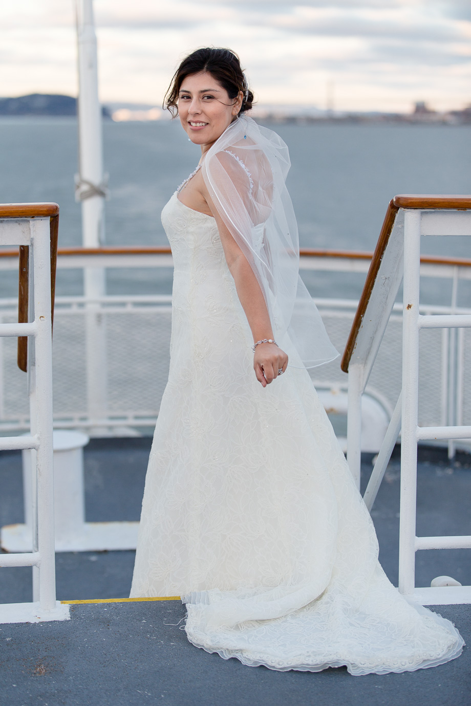 Bride on the top deck of the cruise ship looking back