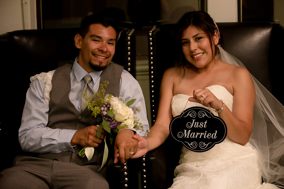 The happy couple holding a Just Married sign