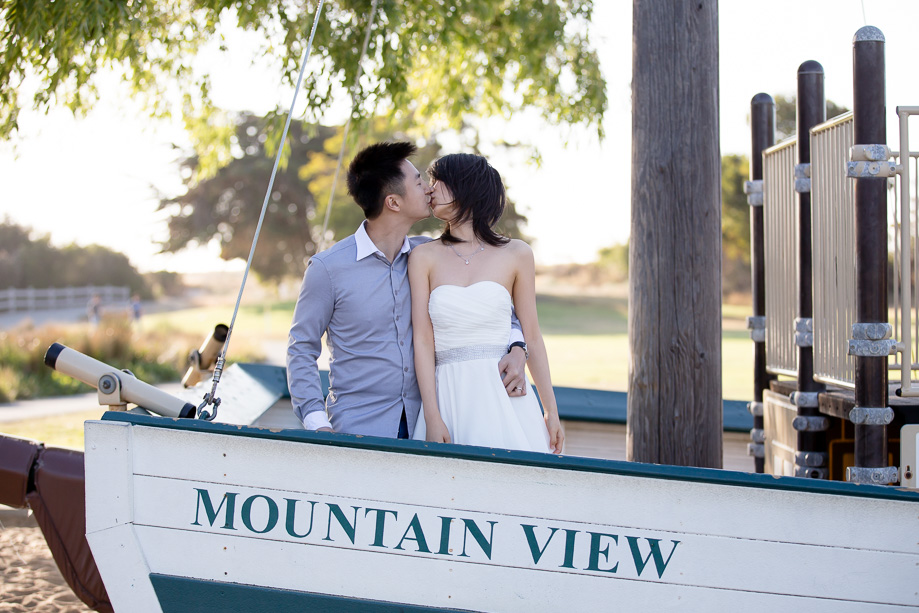 couple kissing on a Mountain View boat playground in a park