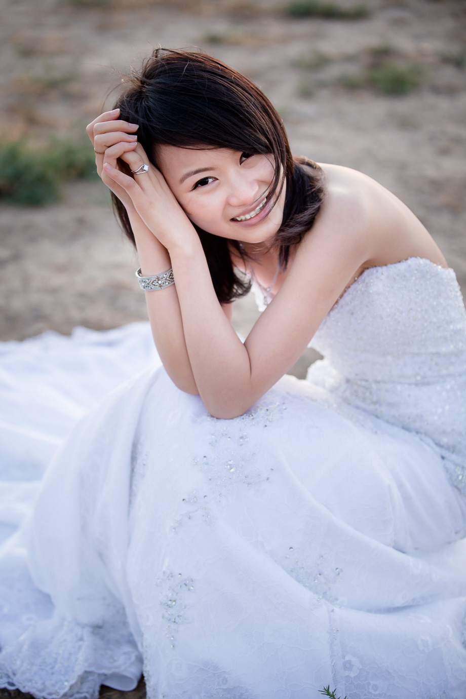 beautiful Asian bridal portrait at park in white wedding dress