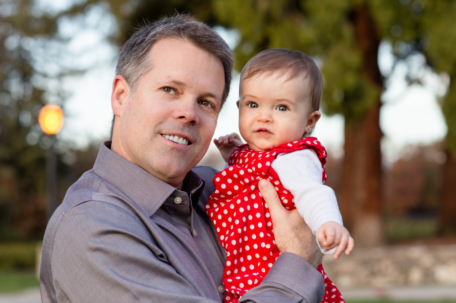 Xmas family photo - happy baby girl with her handsome dad