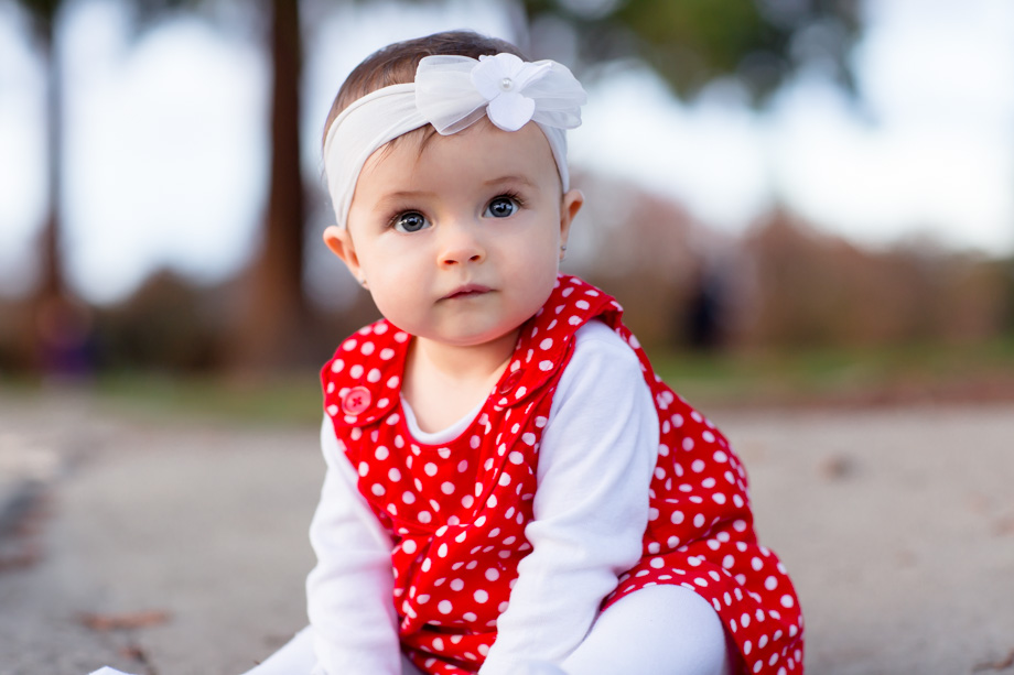 Pretty red polka dot dress and a white floral headband for the cute baby Christmas photo
