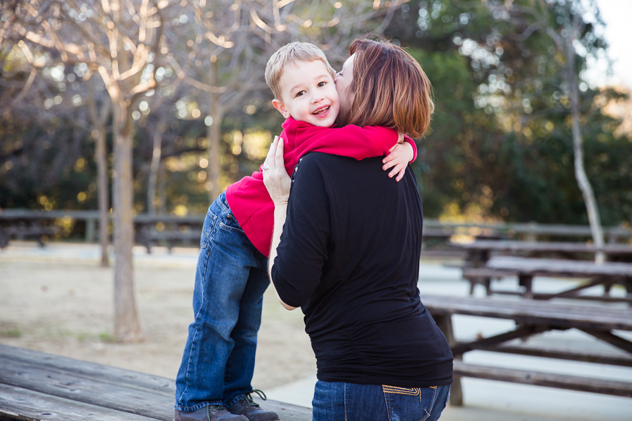 Mother and son sharing a sweet hug in Vasona park