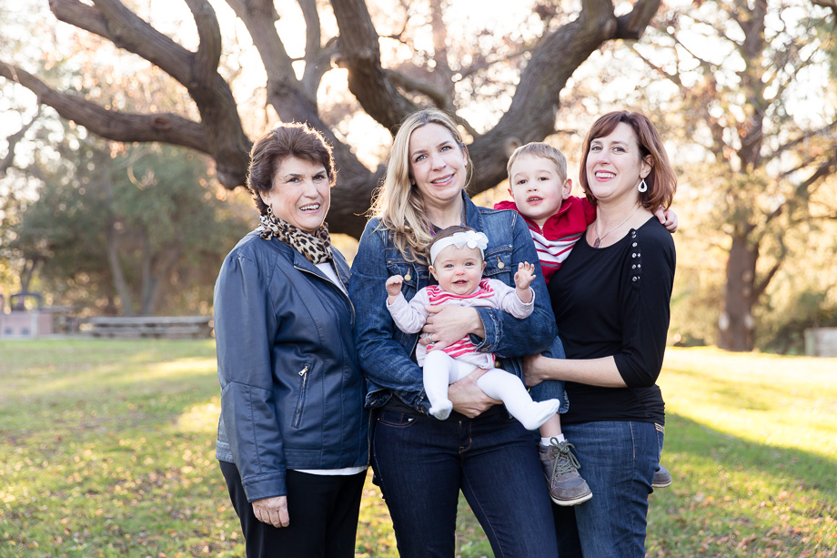 Beautiful three-generation family portrait at Vasona park in the magical sunset lighting