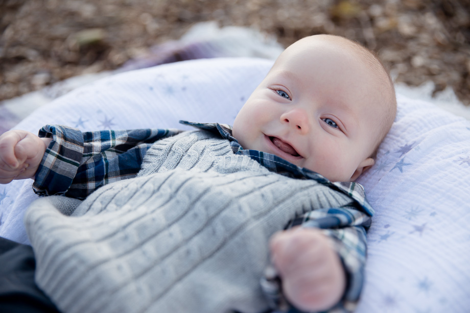 Happy 3 month old baby boy loves smiling at the camera - Vasona park