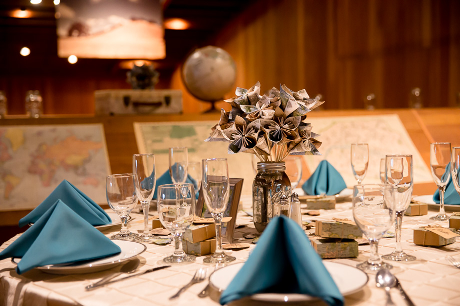 beautiful blue and white reception setup at CuriOdyssey museum - modern travel themed