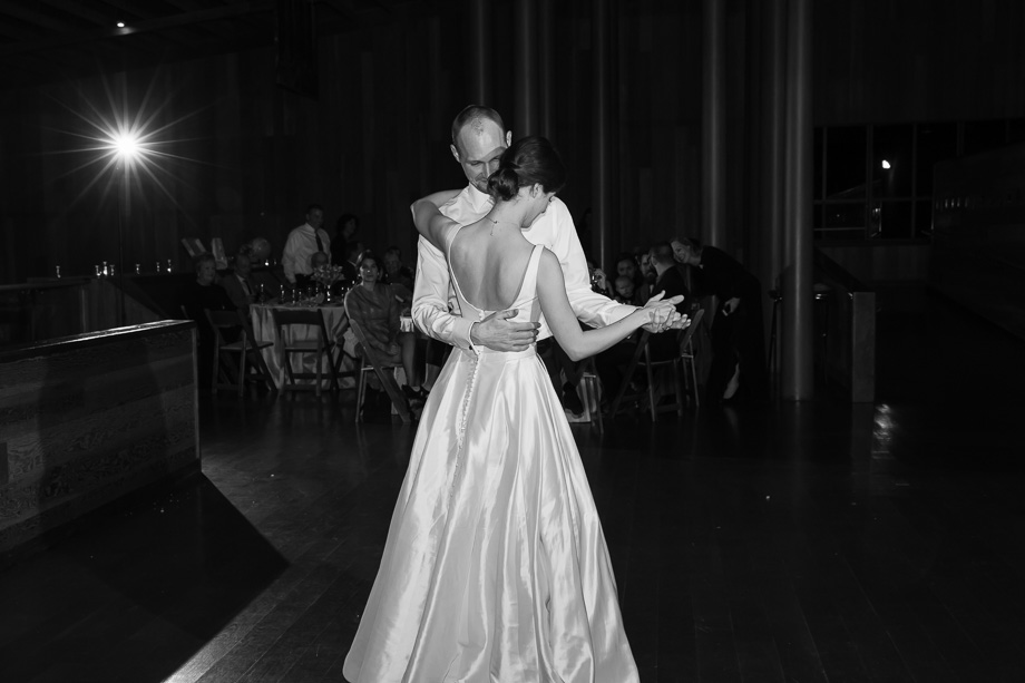 timeless b&w first dance photo at a CuriOdyssey wedding reception