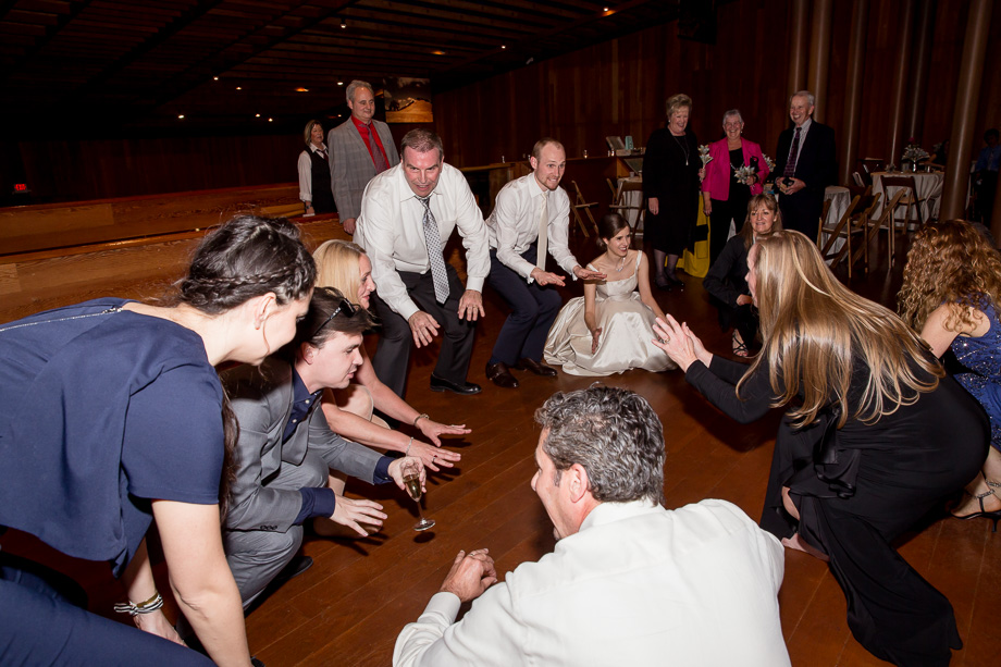 everyone is down on the dance floor at the wedding reception