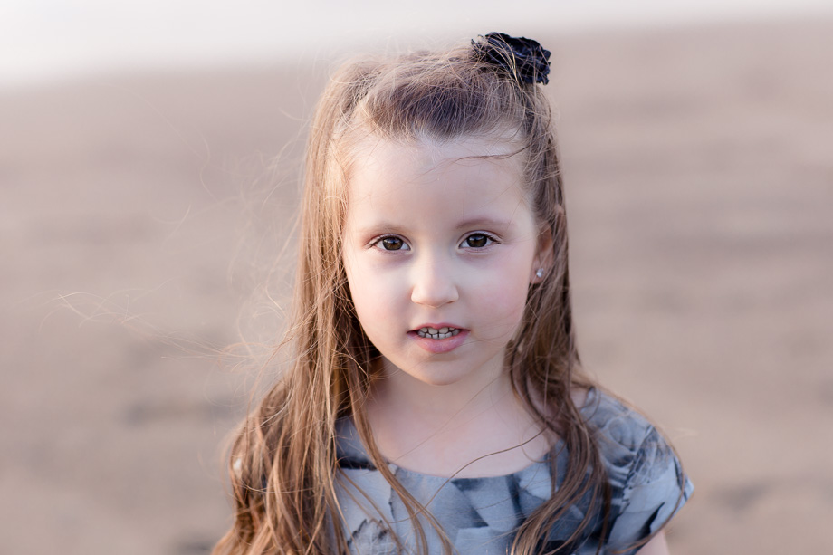 4 year-old girl natural light portrait on the beach at sunset