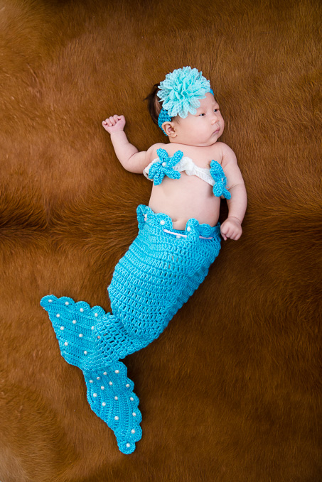 newborn photo in a mermaid costume