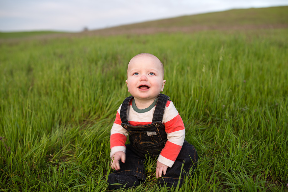 cute baby picture in the grass field