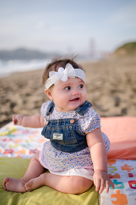 Adorable baby girl portrait at baker beach