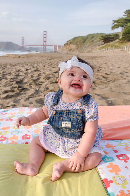 cute 6 month old girl in front of golden gate bridge