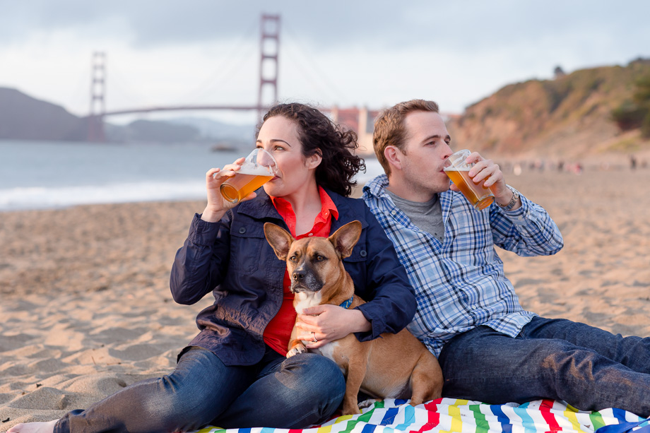 engaged couple chugging craft beer on Baker Beach
