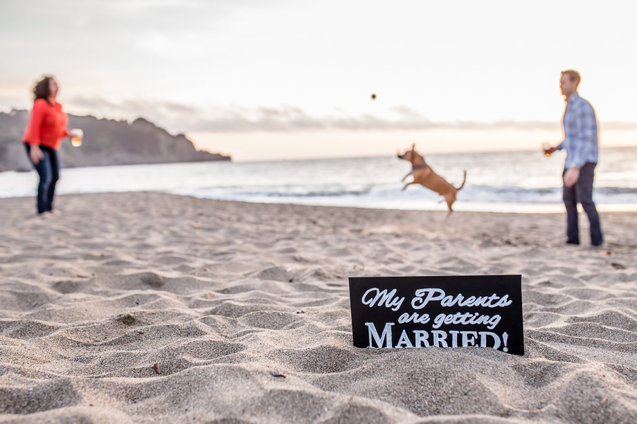 adorable Baker Beach save-the-date photo - DIY dog sign that says my parents are getting married