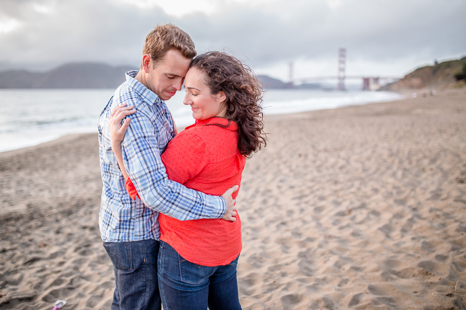 romantic sunset engagement photo in front of the Golden Gate Bridge