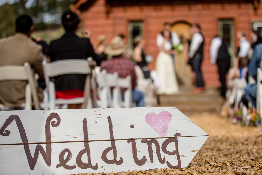 the cute wedding sign at the ceremony site