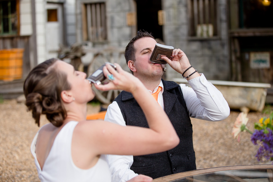 bride and groom shooting whiskey at their reception
