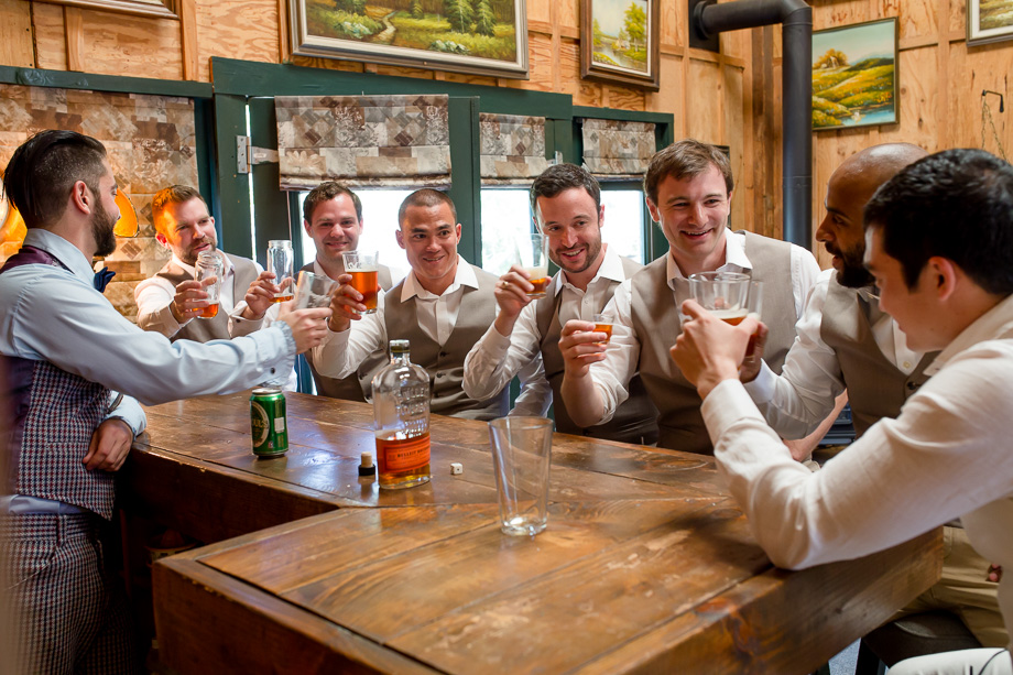 groomsmen and groom drinking before the ceremony