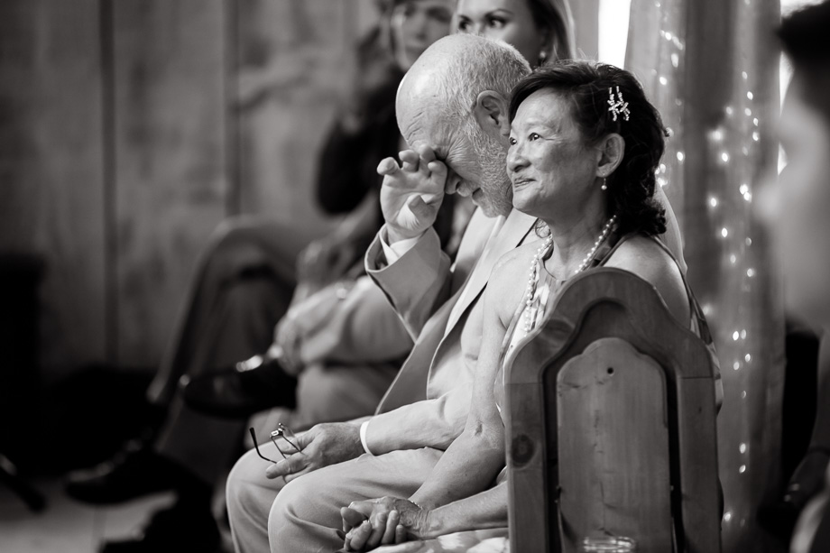 priceless and powerful emotion - grooms parents during the wedding ceremony