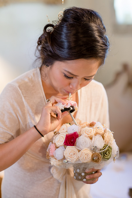 bride sipping beer from a silk bridal bouquet