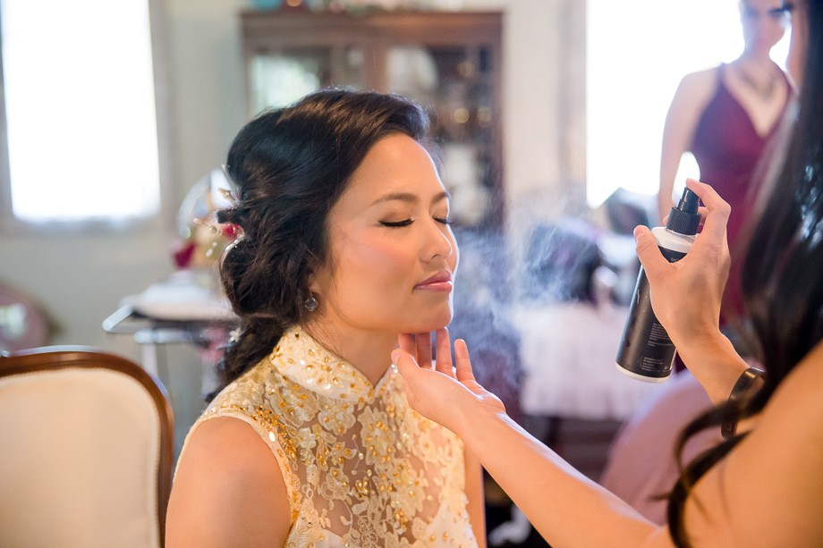bride having her makeup and hair done at the bridal suite