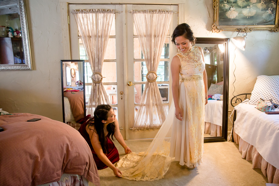 a beautiful wedding dress with a lace train with Vietnamese accents