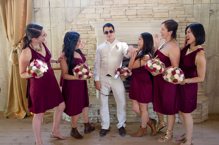 groom with bridesmaids photo