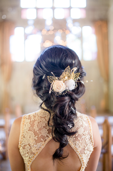 an elegant bridal down do with braids - gold hairpiece