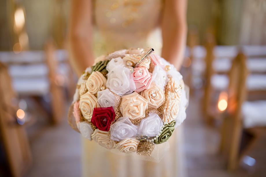 A DIY handmade silk bridal bouquet with hidden beer bottle inside, genius!