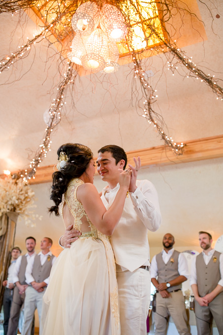 a romantic first dance with blessing from the guests