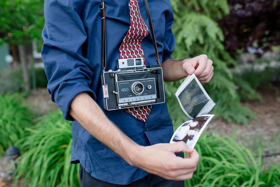 Wedding guest with a cool polaroid camera