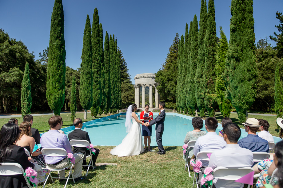 a beautiful wedding ceremony in front of the pulgas water temple