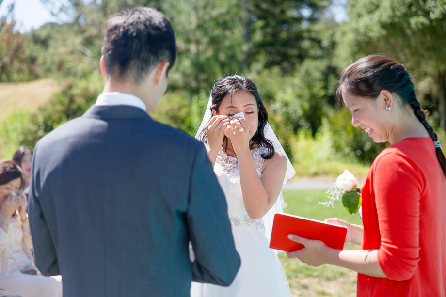 bride wiping away her happy tears at ceremony