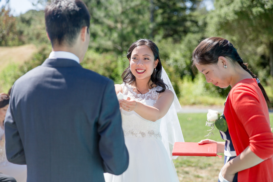 bride passing her tissue to the groom at the ceremony - cute moment