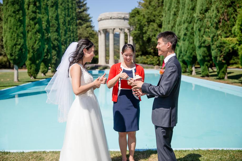 a happy ring exchange in front of the pulgas water temple