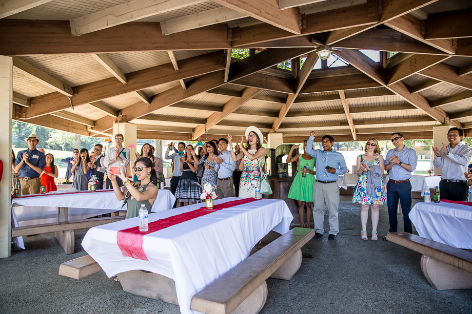 Wedding guests cheering for the newlyweds grand entrance at Gateway Pavilion in Vasona Lake Park