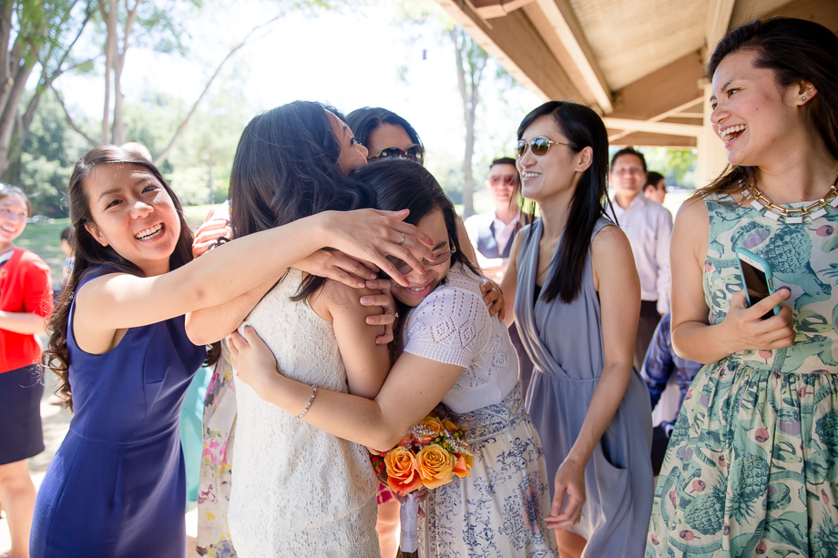 group hug with wedding guests