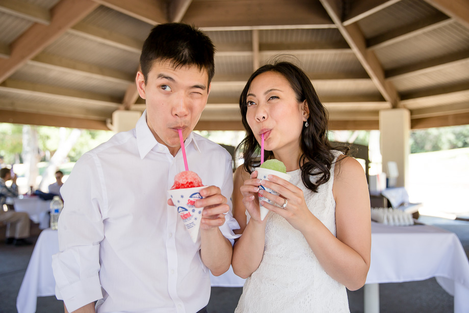 bride and groom enjoying their shaved ice after the train ride at Vasona park