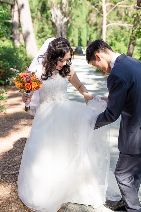 a bug got stuck inside the tulle wedding dress and groom came to the rescue