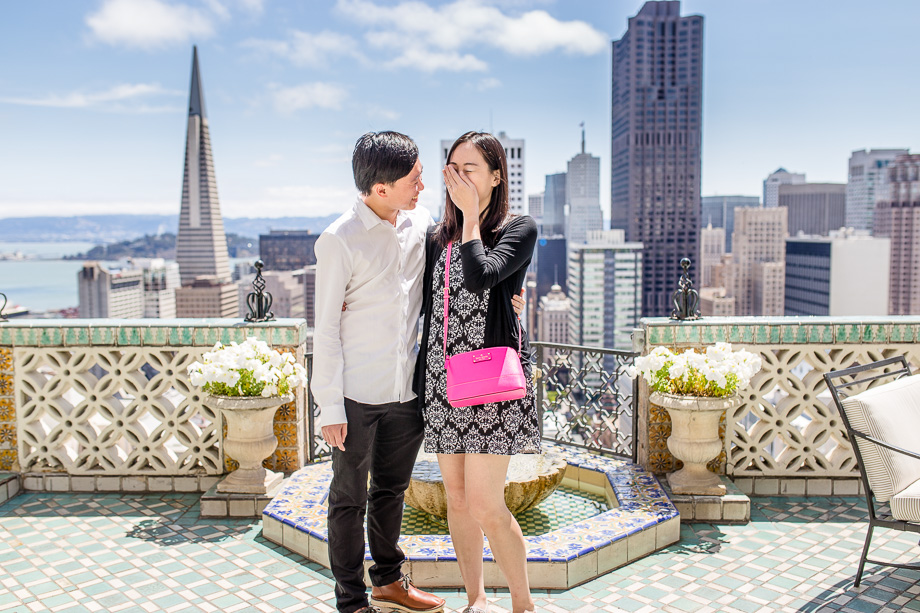 girl is still in shock after the surprise engagement at the rooftop of fairmont san francisco