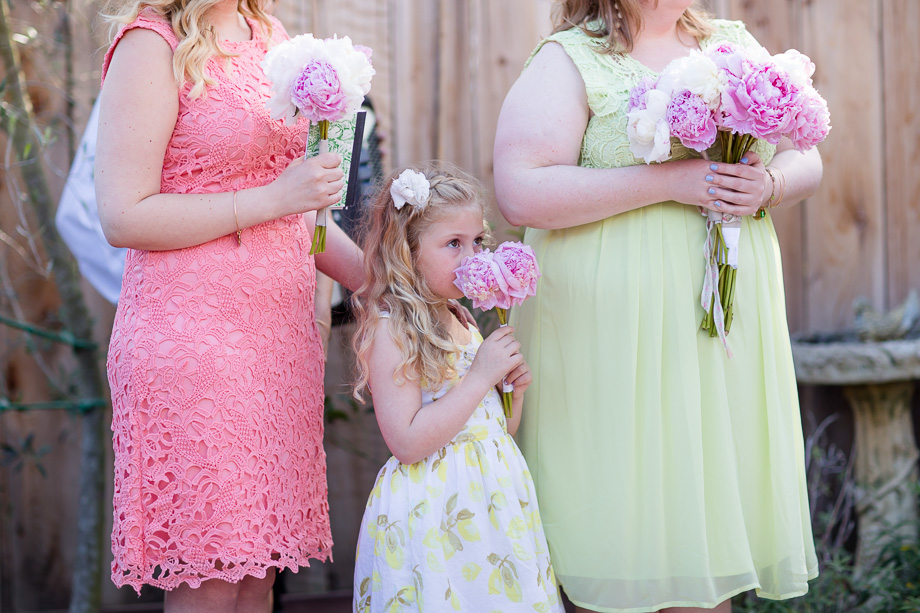 bridesmaids and flower girl at the backyard ceremony
