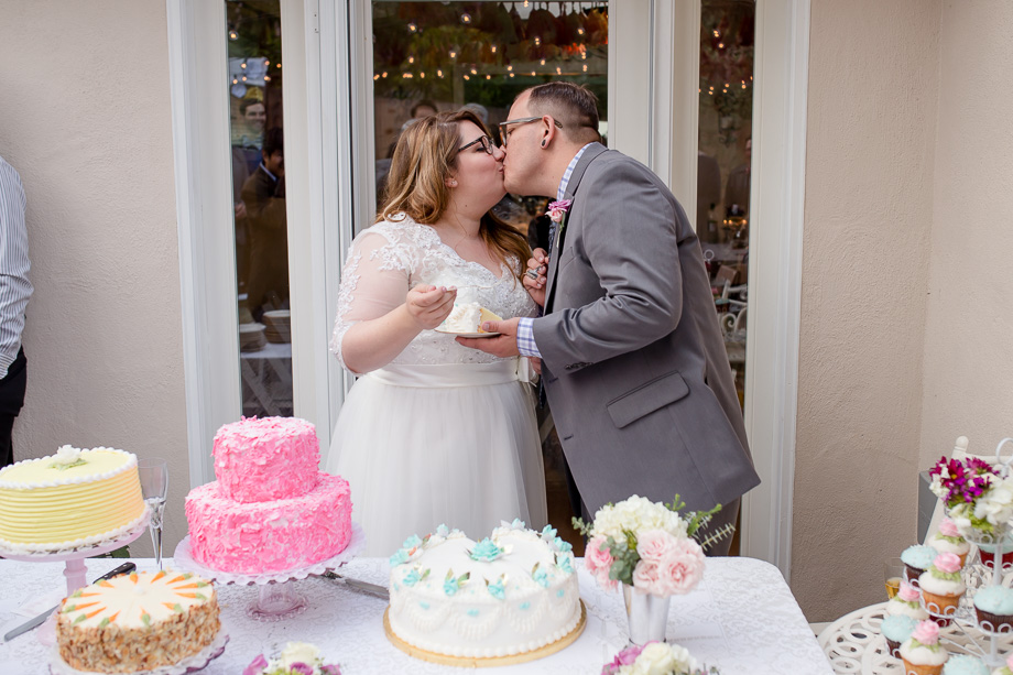 bride and groom feeding each other cake