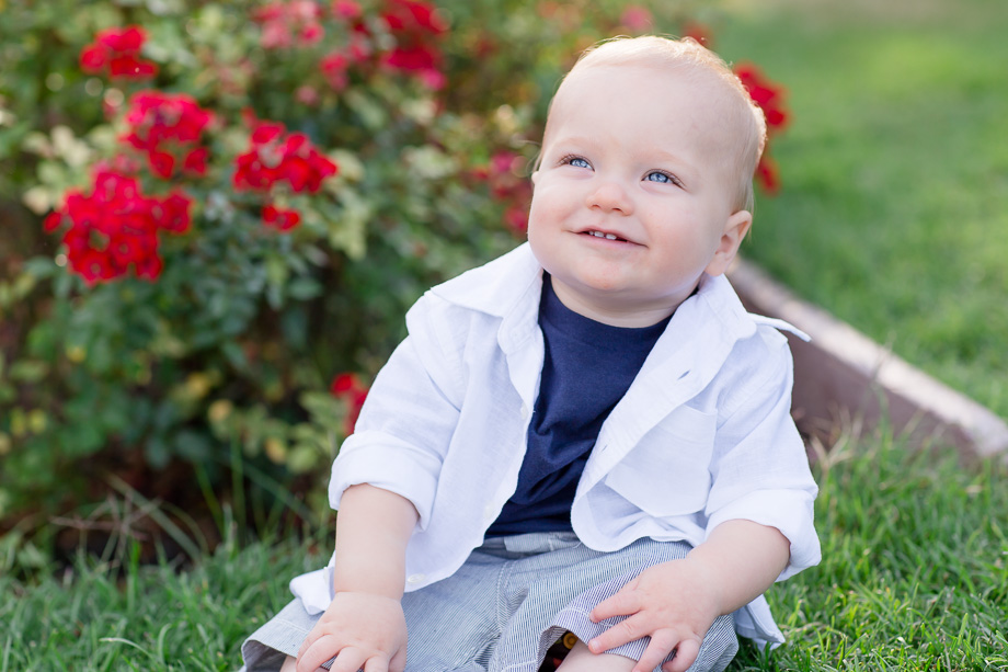 10 month old baby boy smiling at parents